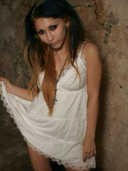 Pics of Angel Button in a white dress