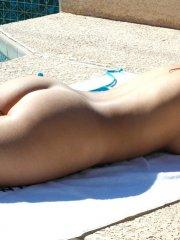 Pictures of Corin Riggs getting naked on a beach towel