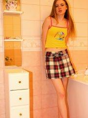 Pictures of Ema's Place dressed in a sexy plaid skirt