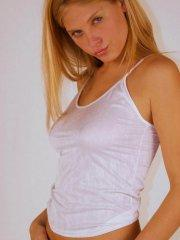Pictures of Erica Star teasing in a white shirt and panties