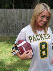 Pictures of teen babe Foxy Jacky playing football in the back yard