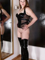 Pictures of Vicky showing her pussy in boots and black lingerie