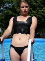 Pictures of GBD Vicky getting wet in a shiny outfit