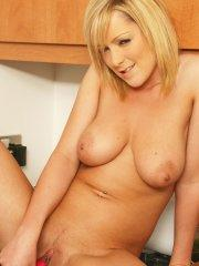 Pictures of Jessica Cutie toying her pussy on the kitchen counter