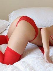 Kari Sweets looking hot in red stockings and lingerie