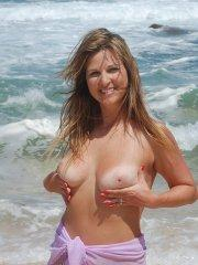 Pictures of Kelly Anderson naked on a beach