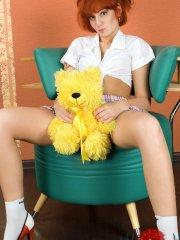 Pictures of teen amateur Maggie Loves Dolls toying her pussy from behind