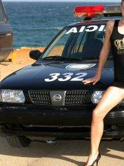 Pictures of Marketa 4 You posing with a cop car