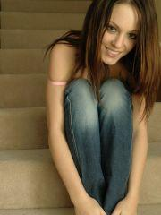 Pictures of Natalie Sparks taking her jeans off on the stairs