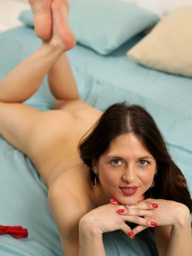 rachel-adjani brunette feet soles on-belly-feet-up