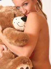 Pictures of Planet Mandy getting cosy with a teddy bear in the studio