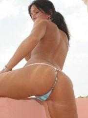 Pictures of Planet Mandy teasing with her huge knockers