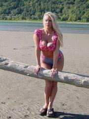 Pictures of Karen Fisher exposing herself on a beach