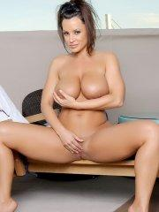 Pictures of Lisa Ann playing with her wet snatch