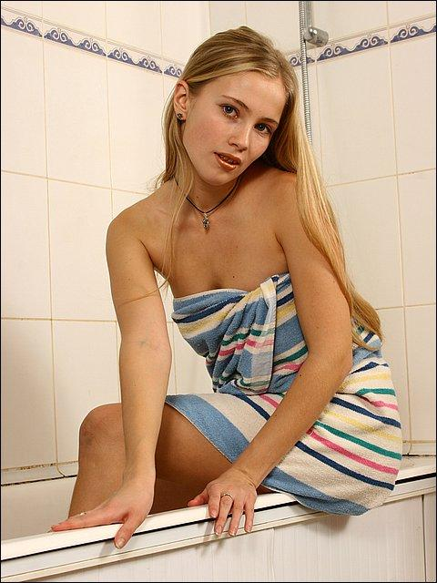 Teen drying off after a shower 10
